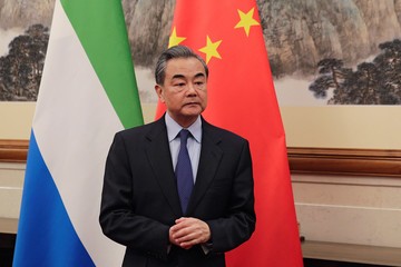 Chinese Foreign Minister Wang Yi looks as he waits for the arrival of Sierra Leone's Foreign Minister Alie Kabba, at the Diaoyutai State Guesthouse in Beijing