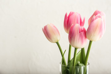 Bouquet of beautiful tulips on light background