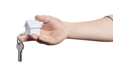 Hand suggesting a key and a small white house, isolated on white background