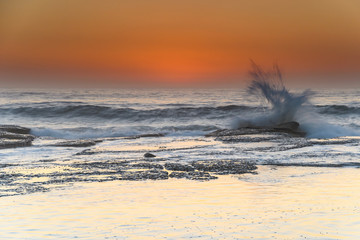 Orange Glow Sunrise Seascape with Splash