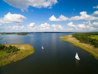 Obraz Aerial view of yachts sailing on Swiecajty Lake, Kal village (former Kehlen or Kielno, East Prussia), Mazury, Poland - fototapety do salonu