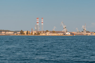 dockyard in Pula with cranes while loading a ship, industry