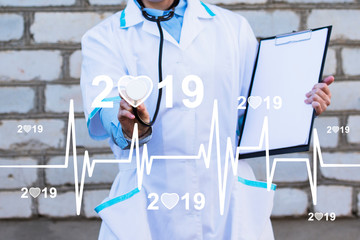 Doctor pushing button heart pulse 2019 healthcare network on online panel medicine.