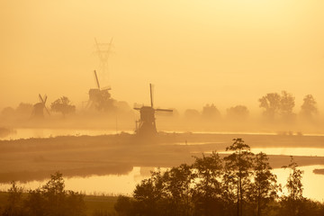 Windmills in a foggy morning in Leiderdorp