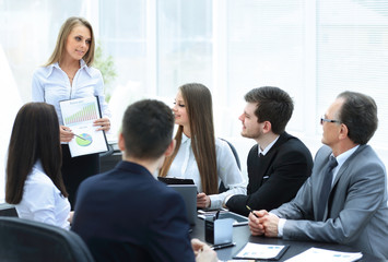 business woman conducting a presentation for business colleagues
