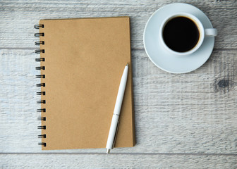 Coffee with pen on notepad