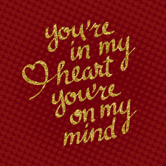 You're In My Heart You're On My Mind golden glittering lettering on red background with hearts. Greeting card template for Valentine's day.