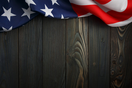 American flag on dark wooden board