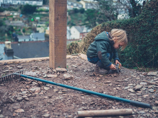 Little toddler playing outside