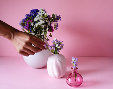 Hand fixing a bouquet of sea lavender flowers