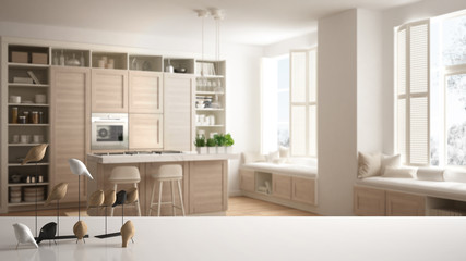 White table top or shelf with minimalistic bird ornament, birdie knick - knack over kitchen with wooden details in contemporary apartment with parquet floor, modern interior design