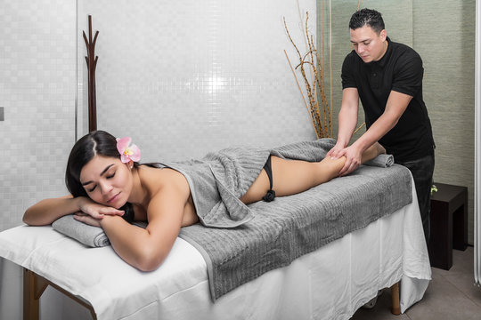 Man giving massage to relaxing woman