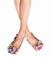 Beautiful woman legs wearing summer high heels isolated over white