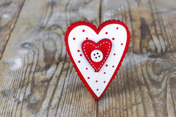 Valentine's Day. red heart on the background of old boards