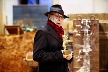 Berlinale International Film Festival director Dieter Kosslick holds a Berlin Bear award during a media tour in Berlin