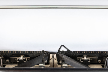 Vintage typewriter with blank sheet of paper retro technology