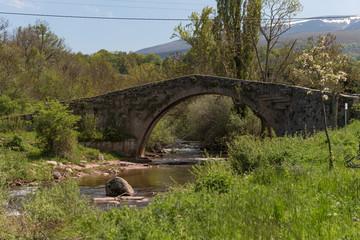 Roman bridge crossing the Hijar river in Entrambasaguas