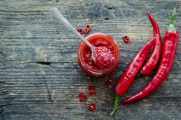 Spoed Fotobehang Kruiderij Red hot chili jam with fresh ingredients