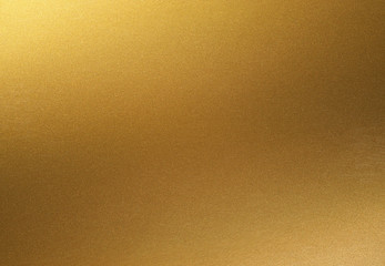 golden shiny gradient background. golden paper with metallic effect.