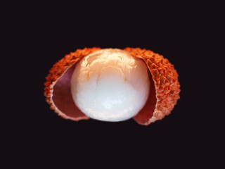 Fresh lychee isolated on black background, macro. Tropical peeled lychee fruit. Litchi chinensis, pinyin, soapberry family, Sapindaceae