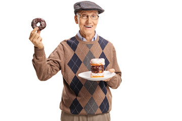 Cheerful senior man holding donught