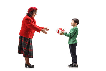 Young boy giving a present to his grandmother
