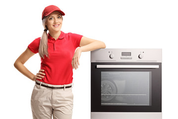 Female sales manager standing next to an electrcal oven