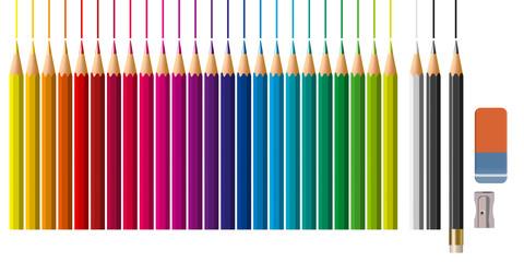 Des fournitures artistiques avec des crayons de couleur alignés suivant un dégradé coloré ainsi qu'un taille crayon et une gomme.