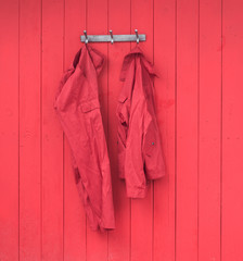 red work clothes on a red wooden wall