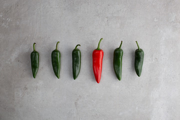Green and red chillies in line be different