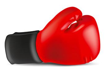 Un gant de boxe rouge posé dur un fond blanc pour symboliser le combat et la victoire sur l'adversaire