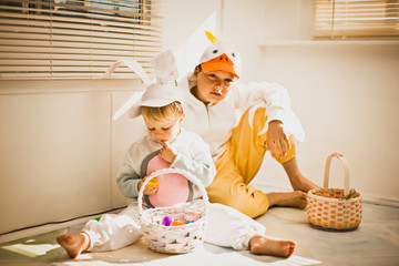 Two brothers dressed up for Easter with their Easter baskets
