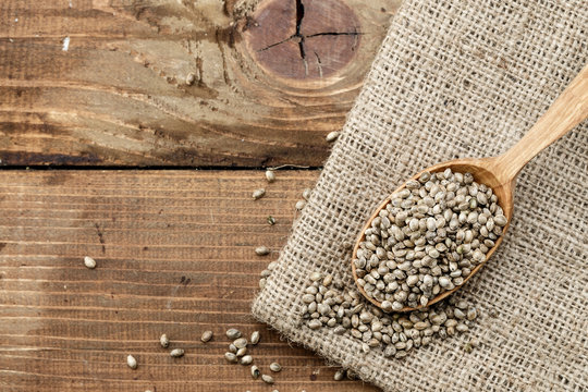 cannabis seeds on wooden background