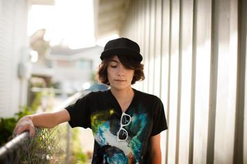Portrait of a teenage boy wearing a hat.