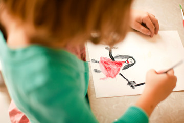 Girl drawing a picture.