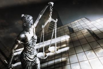 Closeup of a sculpture of Themis, mythological Greek goddess