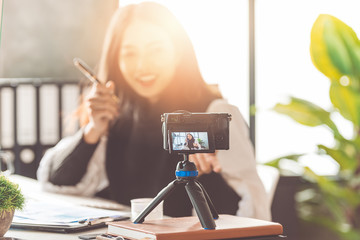 Business woman recording videos for use in online marketing.