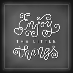 Modern calligraphy lettering of Enjoy the little things in white in mono line style on blackboard background decorated with heart for decoration, poster, banner, motivation, slogan, sticker, greeting