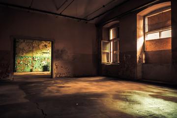Dark interior inside abandoned old factory building