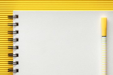 White blank sketchbook with space for text. Mockup. Yellow frame with ribbed paper. Minimal geometrical composition