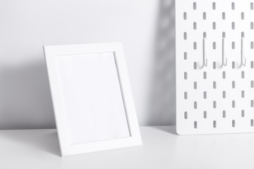 Photo frame on white table