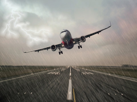 Lightning strike on an airplane in bad weather raining thunderstorm during  landing at the airport runway. Pilots unable to make a successful landing and making a go around. Dangerous hazard concept.