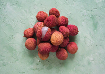 Ripe lychees on a green table. The view from the top.