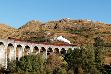 Glenfinnan Viaduct with the Steam Train Jacobite in Scottish Highlands