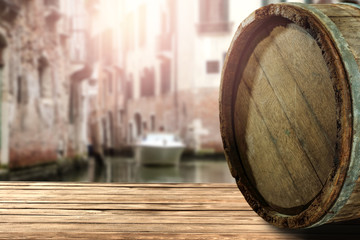 wooden barrel as a table with a free space for an advertising product, the hero on the background of the landscape