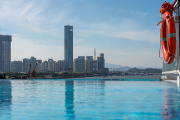 Panorama of the city skyline of Xiamen in China from swimming pool on cruise ship