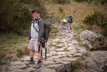 a portrait of a man on a trek