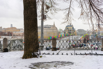 View of the Bolshoy Moskvoretsky Bridge from St. Basil's Cathedral in winter. Moscow, Russia