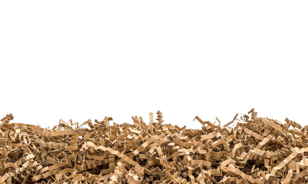 Heap of brown shredded paper for gift isolated on white.