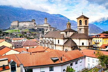 Beautiful ancient city of Bellinzona in Switzerland with Collegiata dei Ss. Pietro e Stefano church and Castelgrande castle on background